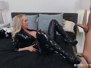 The black leather makes Brandi Love hornier for her friend's dick