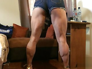 High heel sandals and shorts streching legs