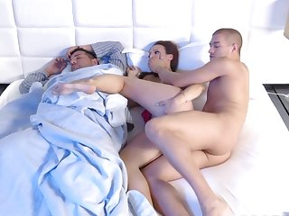 Wife cheats forth her spouse sleeping next to her