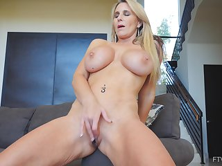 Ainslee takes off her tight dress and fingers her shaved pussy