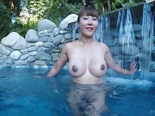 Asian exotic MILF Tiffany spreads her pussy in a pool