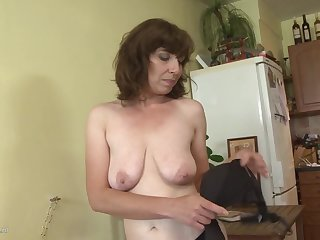Amateur mother with saggy tits and very hairy pussy