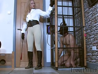 Submissive on a leash licks dirty boots of sexy mistress Dommelia