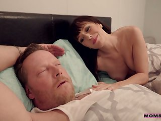 Sex-starved milf Alana Cruise is masturbating pussy in front of sleeping husband