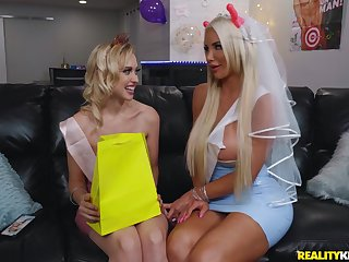 Silicone lesbian diva Nicolette Shea uses a dildo to please her girl