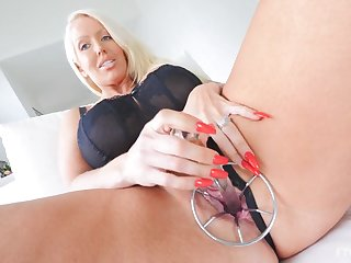 Blonde mature lady Alura pleasuring herself with a lot of toys