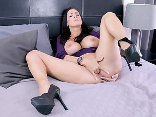 mature on high heels enjoys solo time in bed