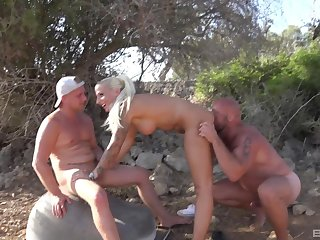 Stuck blonde chick fucked by two horny dudes in the outdoors