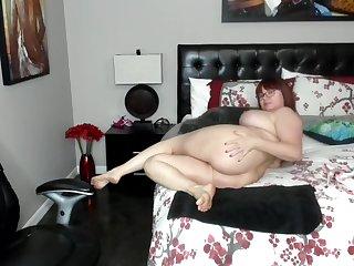 Nerd red head chubby milf teasing her big boobs