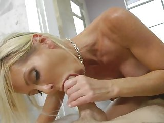 Blonde mom throats and fucks in the steamy bathroom