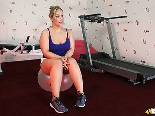 Mature blonde Ashley Rider takes out her natural jugs during hot workout