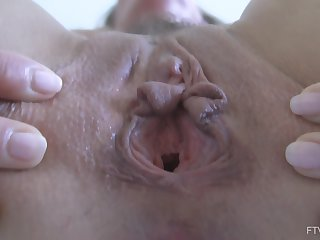 Masturbating with a vibrator makes Eve cum hard and bite her hand