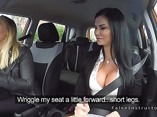Hot blonde girl got talked into licking a friend's pussy in a car